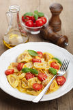 Tortellini with cheese and tomatoes Royalty Free Stock Images