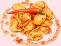 Tortellini with chili sauce Stock Image