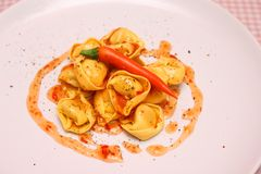 Tortellini with chili sauce Royalty Free Stock Photography