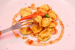 Tortellini with chili sauce Stock Photography