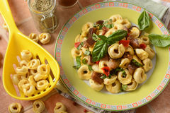 Tortellini with eggplants and peppers Stock Photo
