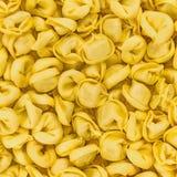 Tortellini emiliani włoski makaronowy makaron faszerował tło teksturę Obraz Royalty Free