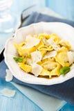 Tortellini with grana padano cheese Royalty Free Stock Photo