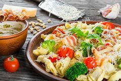 Tortellini with grilled cherry tomatoes, broccoli, red bell pepper, top view Royalty Free Stock Image