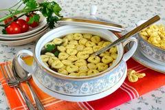 Tortellini in meat broth Stock Image