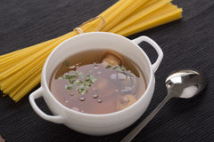 Tortellini in meat soup Stock Image