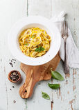 Tortellini with meat. Tortelli Tortellini with meat homemade in white bowl on olive wood cutting board stock image