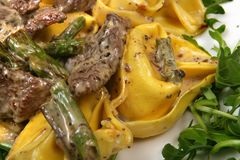 Tortellini with meet and asparagus Stock Image