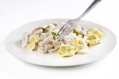 Tortellini with mushroom cream stock photos
