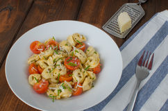 Tortellini with parmesan and tomatoes Royalty Free Stock Photo