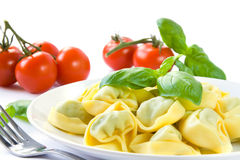 Tortellini pasta. Plate of tortellini pasta with basil and tomatoes stock image