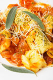 Tortellini pasta in basilico sauce Royalty Free Stock Images