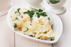 Tortellini pasta in cheese sauce Stock Photos