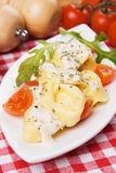 Tortellini pasta with cheese sauce and tomato Stock Photos