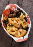Tortellini pasta in olive and tomato sauce Royalty Free Stock Photos
