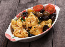Tortellini pasta in olive and tomato sauce Stock Photography