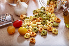 Tortellini pasta on a table. Tortellini pasta on a wooden table Royalty Free Stock Photos