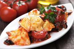 Tortellini pasta with tomato and olive sauce Royalty Free Stock Photo