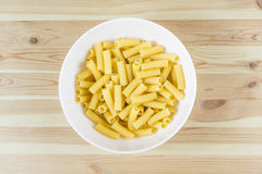 Tortellini pasta uncooked in bowl top view royalty free stock photo