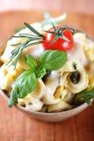 Tortellini with pesto and sauce Stock Photo