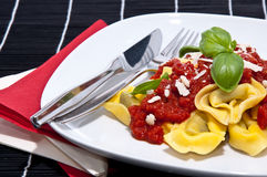 Tortellini on a plate against black background Royalty Free Stock Images