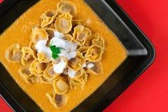 Tortellini with Pork Ragù in Milk & Carrots Royalty Free Stock Photo