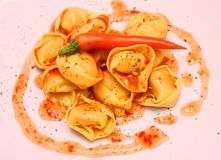 Tortellini with soft herb sauce Stock Photo