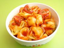 Tortellini. Some fresh tortellini with a sauce of tomatoes stock images