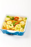 Tortellini soup Stock Images