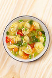 Tortellini soup Stock Photo