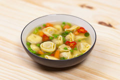 Tortellini soup Stock Photos