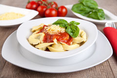 Tortellini with tomato and basil sauce royalty free stock photography