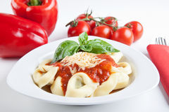 Tortellini with tomato and basil sauce royalty free stock photos