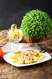 Tortellini with tomato, ham and cream Royalty Free Stock Images