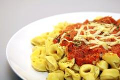 Tortellini with tomato sauce Stock Photos