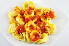 Tortellini with tomato sauce Stock Photos