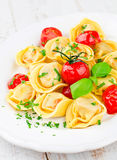 Tortellini with tomatoes. And basil royalty free stock image