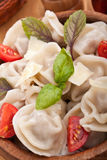 Tortellini with tomatoes and basil Royalty Free Stock Images
