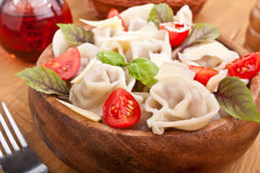 Tortellini with tomatoes and basil Royalty Free Stock Photography