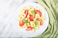 Tortellini with tomatoes and basil Royalty Free Stock Photo