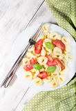 Tortellini with tomatoes and basil Royalty Free Stock Image