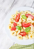 Tortellini with tomatoes and basil Stock Image