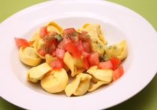Tortellini with tomatoes Stock Photo