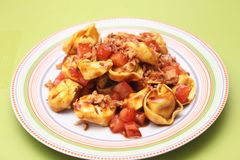 Tortellini with tomatoes Stock Photography