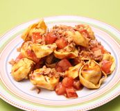 Tortellini with tomatoes Royalty Free Stock Images
