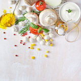 Tortellini and vegetables on white wooden background Stock Photos