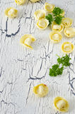 Tortellini and vegetables. On white wooden background Stock Photography