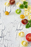 Tortellini and vegetables. On white wooden background Stock Image