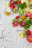 Tortellini and vegetables. On white wooden background Royalty Free Stock Photos