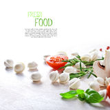 Tortellini and vegetables on white wooden background Stock Images